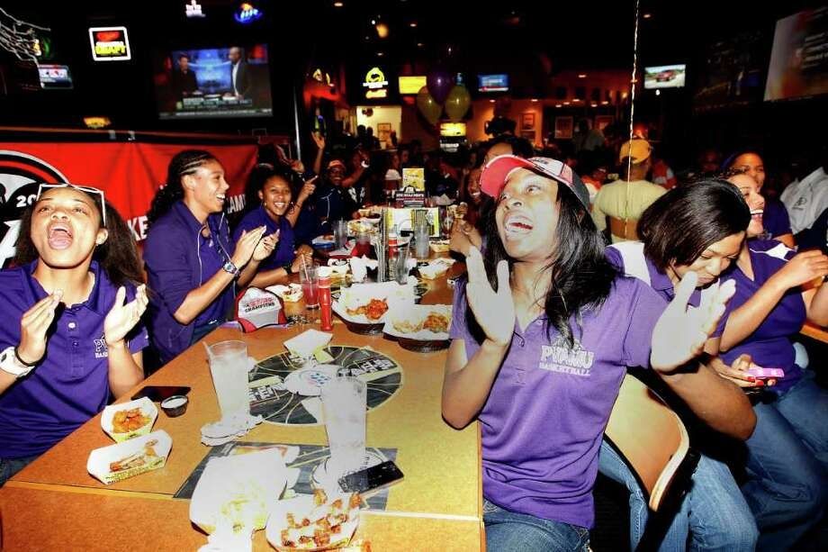 Prairie View A&M women's basketball players Michaela Burton, left, and LaReahn Washington, right, react at the NCAA selection show watch party Monday, March 12, 2012, in Houston, as it was announced that the Prairie View will play against UCONN in the first round of the upcoming women's NCAA basketball tournament. Photo: Karen Warren, Houston Chronicle / © 2012  Houston Chronicle