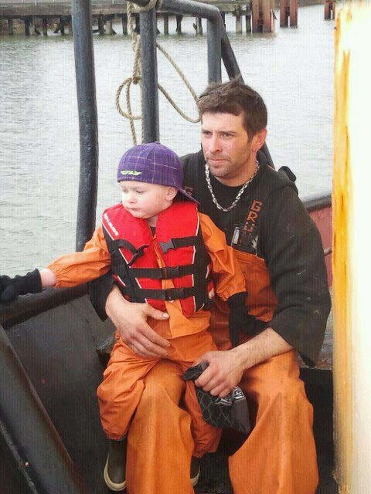 Jason Bjaranson, shown with his son, Talon, had texted his girlfriend before he went missing.