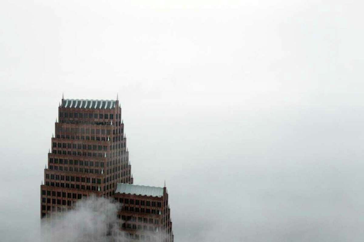 The Bank Of America Center is seen through the fog Monday, March 12, 2012, in downtown Houston.