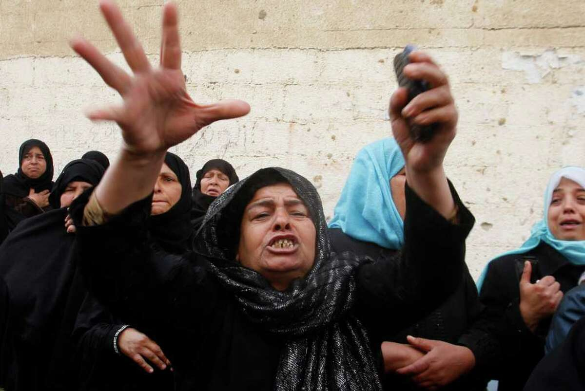 A Palestinian woman reacts during the funeral of Islamic Jihad militant Hamada Mataleg, killed in an Israeli air strike Sunday, in Khan Younis, southern Gaza Strip, Monday, March 12, 2012. Israeli airstrikes killed two Palestinian militants and a schoolboy in the Gaza Strip on Monday and Palestinian rocket squads barraged southern Israel, in escalating fighting that has defied international truce efforts. (AP Photo/Hatem Moussa)