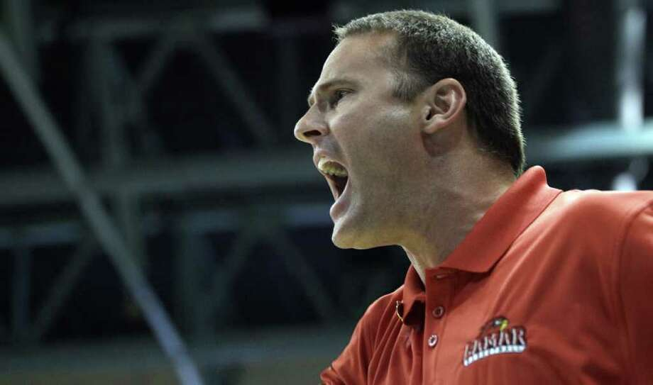FILe - In this March 10, 2012 file photo, Lamar coach Pat Knight yells at an official during the second half of the Southland Conference tournament championship basketball game in Katy, Texas. Pat Knight's Lamar University team has won six straight games, made the NCAA tournament and given Bob Knight's son a chance to step out on his own.  (AP Photo/David J. Phillip, File) Photo: David J. Phillip, STF / AP2012