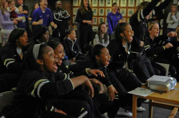 UAlbany women's basketball players celebrate after finding out they would be playing Texas A & M this Saturday in Texas in the NCAA Division I women's basketball tournament, on Monday night March 12, 2012 in Albany, N.Y.  The team gathered to watch a televised tournament selection show to find out where they would be playing. (Philip Kamrass / Times Union ) Photo: Philip Kamrass / 00016764A