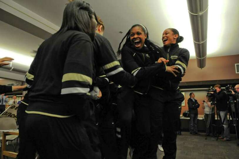 UAlbany women's basketball players Cyndra Couch, left, and Cassandra Callaway, right, celebrate with