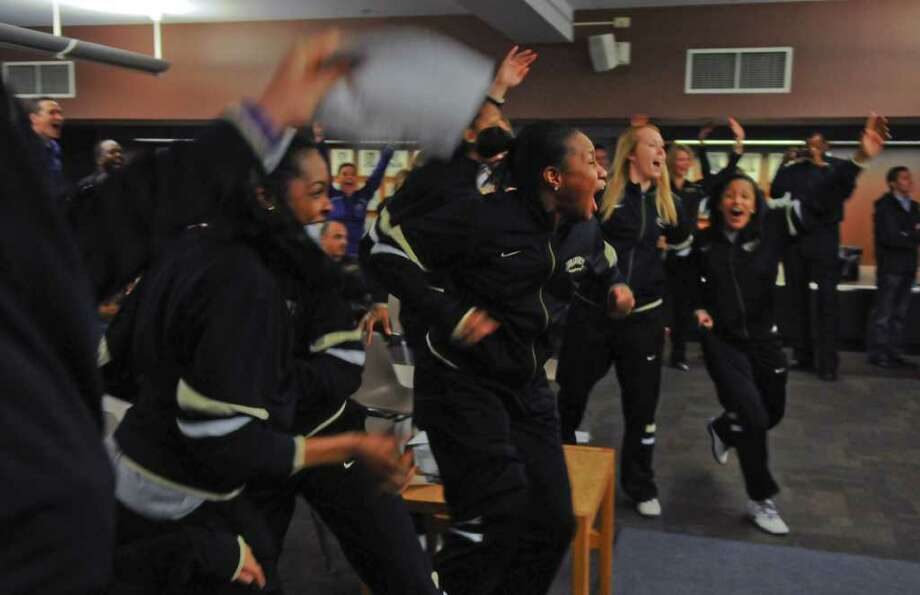 UAlbany women's basketball players celebrate after finding out they would be playing Texas A & M