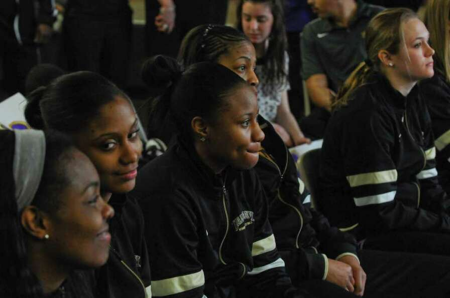UAlbany women's basketball players anxiously watch a televised NCAA tournament selection show to fin
