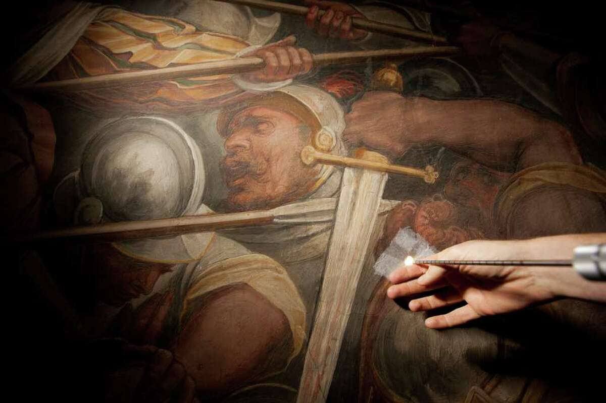 A photo released Monday shows a sampling tool about to be placed into the Vasari wall in Florence's Palazzo Vecchio to extract material for analysis.