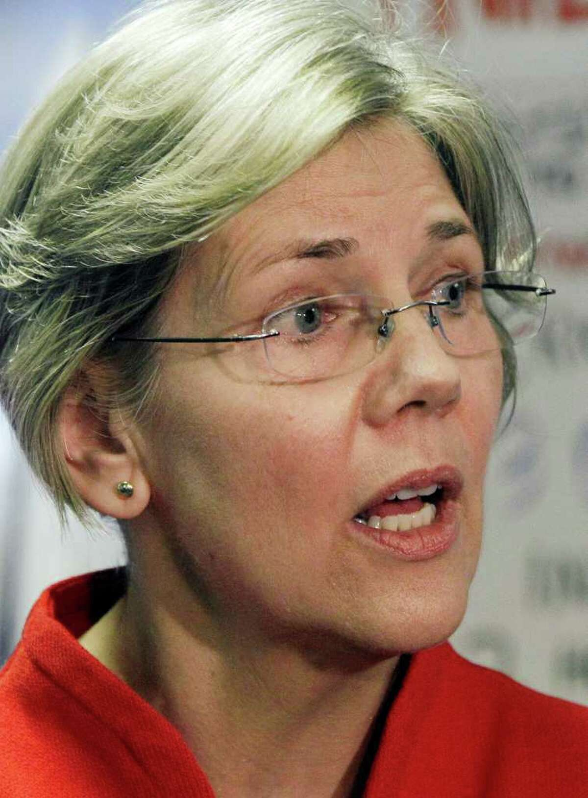 FILE - In this Feb. 27, 2012 file photo, Democrat Elizabeth Warren, who is seeking the U.S. Senate seat held by Republican Scott Brown, speaks during a news conference at her campaign headquarters in Somerville, Mass. Warren is tapping the wallets of lawyers, academics, union members and filmmakers, while Brown is relying heavily on donations from the financial and health care sectors, as they raise funds for what could be the costliest Senate race in Massachusetts?s history. (AP Photo/Elise Amendola, File)
