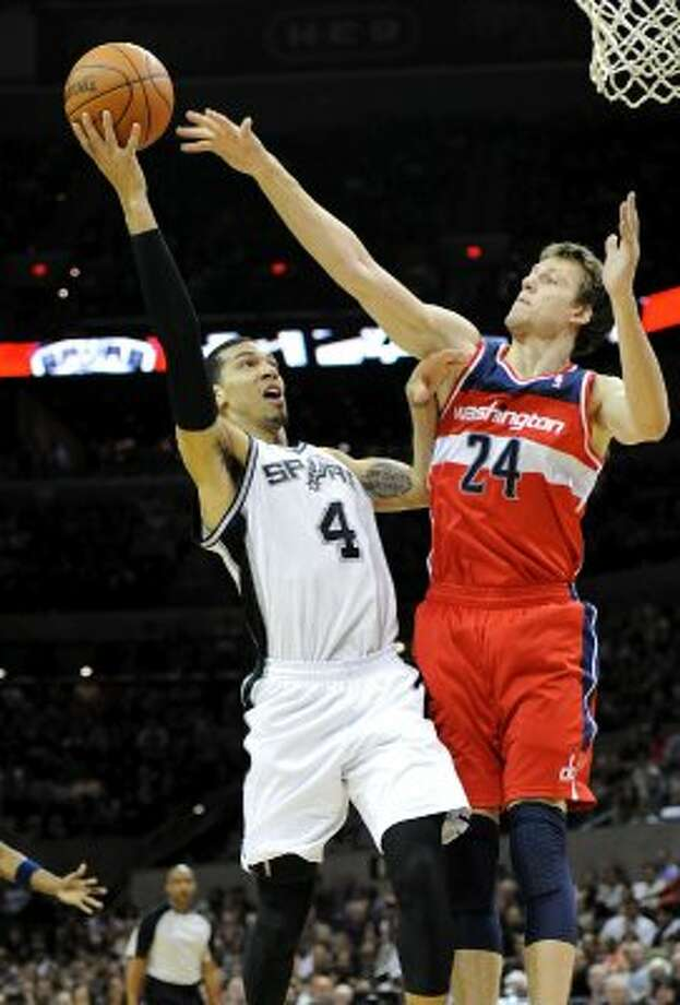 San Antonio Spurs guard Daniel Green (4) tries to get off a shot over Washington Wizards forward Jan Vesely (24)  during a NBA basketball game between the Washington Wizards and the San Antonio Spurs at the AT&T Center in San Antonio, Texas on March 12, 2012.