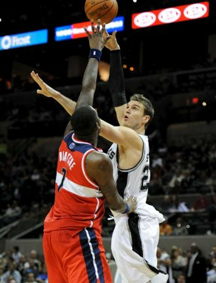 San Antonio Spurs center Tiago Splitter (22) takes a hook shot over Washington Wizards power forward Andray Blatche (7) during a NBA basketball game between the Washington Wizards and the San Antonio Spurs at the AT&T Center in San Antonio, Texas on March 12, 2012.
