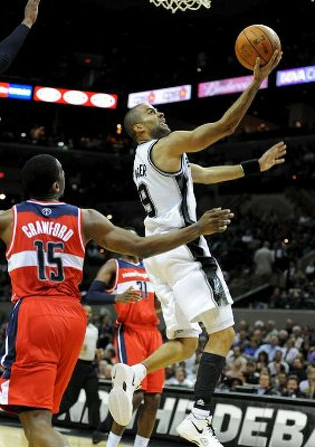 San Antonio Spurs point guard Tony Parker (9) puts up a layup during a NBA basketball game between the Washington Wizards and the San Antonio Spurs at the AT&T Center in San Antonio, Texas on March 12, 2012.