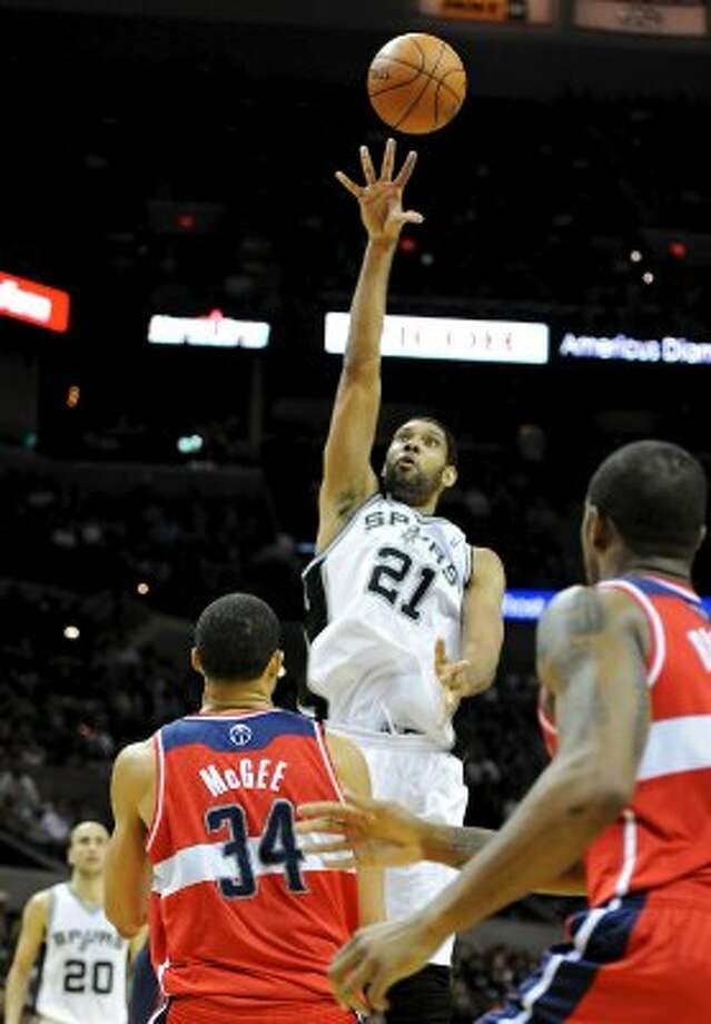 San Antonio Spurs center Tim Duncan (21) takes a shot over Washington Wizards center JaVale McGee (34) during a NBA basketball game between the Washington Wizards and the San Antonio Spurs at the AT&T Center in San Antonio, Texas on March 12, 2012.