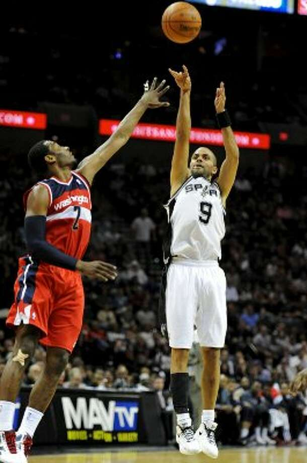 San Antonio Spurs point guard Tony Parker (9) takes a shot over Washington Wizards point guard John Wall (2) during a NBA basketball game between the Washington Wizards and the San Antonio Spurs at the AT&T Center in San Antonio, Texas on March 12, 2012. John Albright / Special to the Express-News. (San Antonio Express-News)