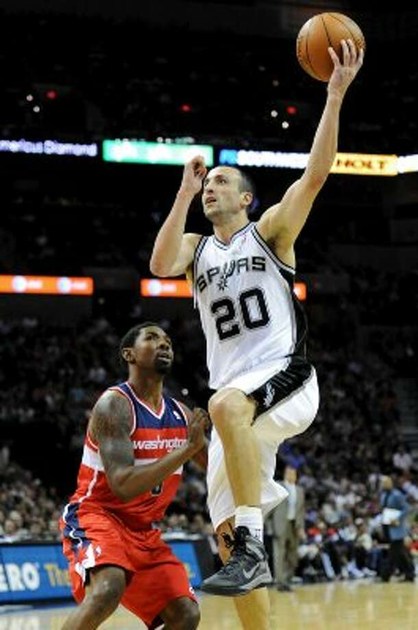 San Antonio Spurs shooting guard Manu Ginobili (20) puts up a shot during a NBA basketball game between the Washington Wizards and the San Antonio Spurs at the AT&T Center in San Antonio, Texas on March 12, 2012.