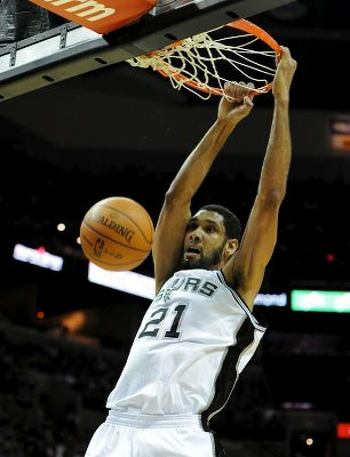 San Antonio Spurs center Tim Duncan (21) dunks the ball during a NBA basketball game between the Washington Wizards and the San Antonio Spurs at the AT&T Center in San Antonio, Texas on March 12, 2012. John Albright / Special to the Express-News. (San Antonio Express-News)