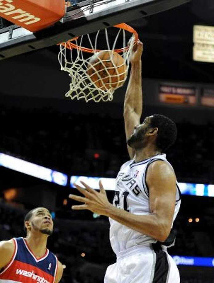 San Antonio Spurs center Tim Duncan (21) dunks the ball during a NBA basketball game between the Washington Wizards and the San Antonio Spurs at the AT&T Center in San Antonio, Texas on March 12, 2012.