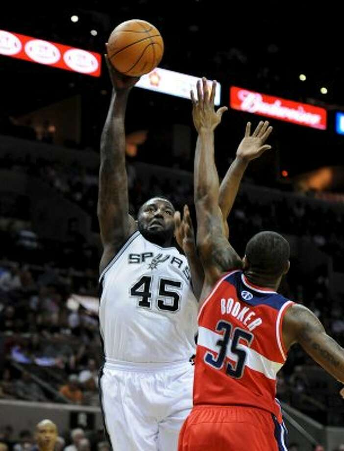 San Antonio Spurs forward DeJuan Blair (45) puts up a shot over Washington Wizards power forward Trevor Booker (35) during a NBA basketball game between the Washington Wizards and the San Antonio Spurs at the AT&T Center in San Antonio, Texas on March 12, 2012.