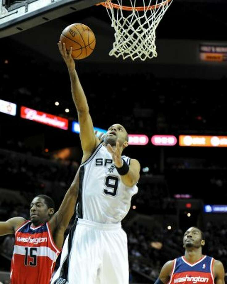 San Antonio Spurs point guard Tony Parker (9) puts up an easy layup during a NBA basketball game between the Washington Wizards and the San Antonio Spurs at the AT&T Center in San Antonio, Texas on March 12, 2012.