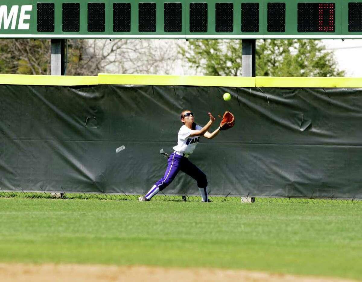 Warren's Monica Nevarez runs to catch a ball against Warren during a game on Monday, March 12, 2012. Bob Owen/Express-News