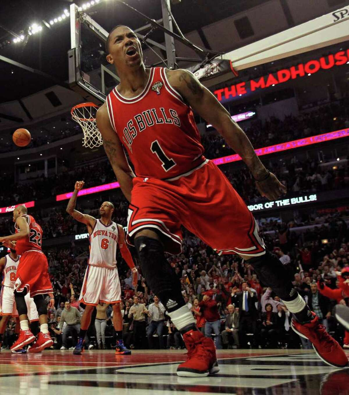 Chicago's Derrick Rose (1) feels it after a dunk against the visiting Knicks on Monday night. Rose finished with 32 points in the Bulls' 104-99 victory.