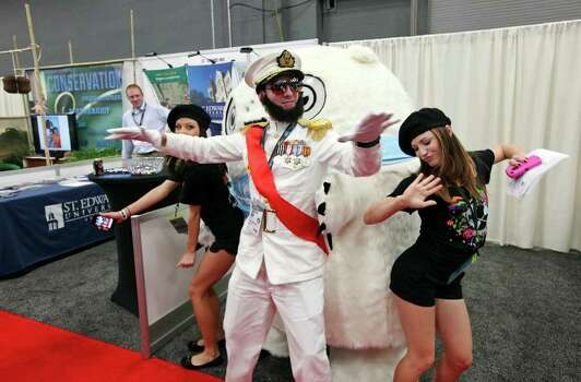 "David Stepanyan, as ""The Dictator"" (center) and Gabriela Bogner (left) and Lori Brown as his entourage dance with the ""Glomper"" while advertising Equilibrium's EQ Network during the South by Southwest trade show Monday, March 12, 2012 at the Austin Convention Center in Austin. Photo: EDWARD A. ORNELAS, San Antonio Express-News / © SAN ANTONIO EXPRESS-NEWS (NFS)"