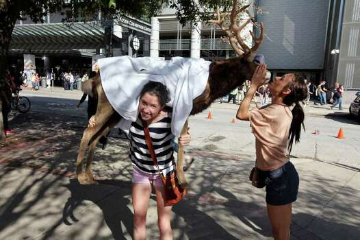 University of Texas at Austin students Ginny Simon, 22,  (left) and Julie Amthor, 21, pose for a photo with the Nokia Lab's reindeer during South by Southwest Monday, March 12, 2012 in Austin. Photo: EDWARD A. ORNELAS, San Antonio Express-News / © SAN ANTONIO EXPRESS-NEWS (NFS)