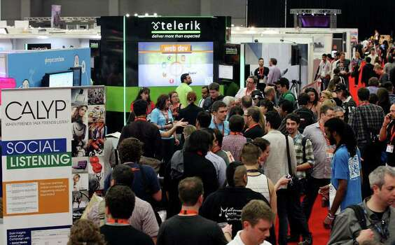 People attend the South by Southwest trade show Monday, March 12, 2012 at the Austin Convention Center in Austin. Photo: EDWARD A. ORNELAS, San Antonio Express-News / © SAN ANTONIO EXPRESS-NEWS (NFS)