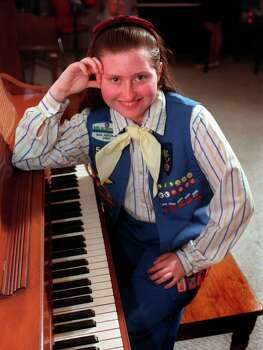 Girl Scout Kathryn Marie Archuleta, photographed April 9, 1999, organizes charity events for and teaches music to children with disabilities. In May, she will receive an award for her work. Photo: WILLIAM LUTHER, Express-News File Photo / EN