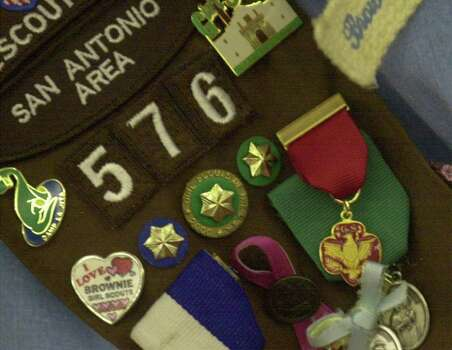The Girl Scout Medal of Honor hangs on the uniform sash of Melani Lozano after she received the medal on Dec. 21, 2001. Photo: BILLY CALZADA, Express-News File Photo