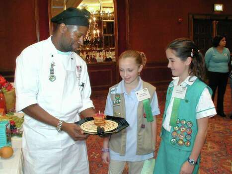 Patrick Brown (sous chef at Central Market), Randi Mabry (Troop 766) and Kate Goudge (Troop 970) admire the work of Brown at the Adam's Mark Hotel on Feb. 12, 2002, during the Great Girl Scout Cookie Contest. Photo: LELAND A. OUTZ, Express-News File Photo / SAN ANTONIO EXPRESS-NEWS