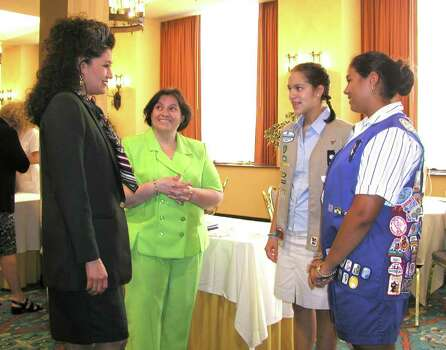 Rose Gonzalez Perez (assistant executive director of Girl Scouts of the S.A. area), Hada Reed (membership program and diversity consultant with Girl Scouts of the USA), Laura Hernandez (cadet) and Katrina Stanigar (Girl Scout) were at the Holiday Inn Riverwalk hotel on July 18, 2002, for the Latinas in Girl Scouting national conference. Photo: LELAND A. OUTZ, Express-News File Photo / SAN ANTONIO EXPRESS-NEWS
