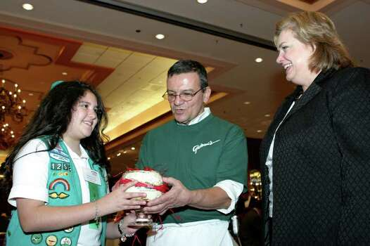Brittany Arevalos (top Girl Scout cookie seller), Giovanni Gagliano (celeb chef) and Sharon Jones Schweitzer (president of the board of directors S.A. American Girl Scouts Council) were at the Crowne Plaza Hotel on Feb. 24, 2005, for the Girl Scouts Cookie Concoction event. Photo: LELAND A. OUTZ, Express-News File Photo / SAN ANTONIO EXPRESS-NEWS