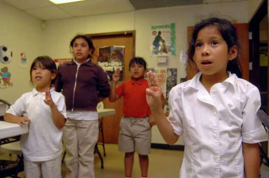 Jackie Hilario, 9, joins other Girl Scouts in reciting the pledge during an afterschool meeting at the Katie M. Jones Girl Scout Center on Thursday, May 11, 2006. The center, part of the Martin Luther King Service Unit, is receiving a $750,000 Kronsky Grant. May 11, 2006. Photo: BILLY CALZADA, Express-News File Photo / SAN ANTONIO EXPRESS-NEWS