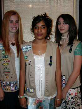 Three Northeast Side girls — Courtney Sheridan (from left), Indarani Phillip and Celia Alecozay — recently earned the Girl Scout Gold Award, the organization's highest award. The teens all did many hours of community serve and a special project to earn the Gold Award. Courtesy photo. Photo: Express-News File Photo