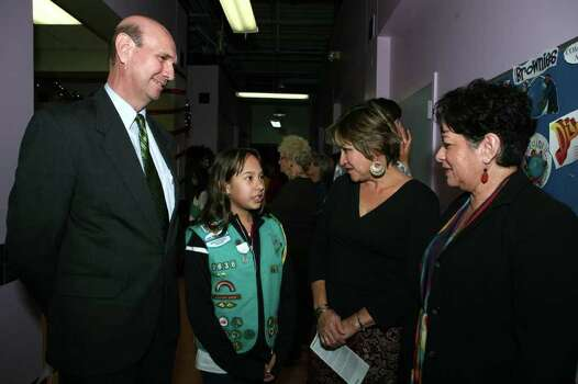 "J.R. ""Corky"" Rubio (board chair Girl Scouts of South Texas), Christina Salazar (Girl Scout Junior), Deborah Vasquez and Rosie Abreu (co chairs advisory committee) were at the 15th anniversary of the Avenida Girl Scout Troop on Dec. 4, 2008, at Avenida Guadalupe Girl Scout Center. Photo: LELAND A. OUTZ, Express-News File Photo / SAN ANTONIO EXPRESS-NEWS"
