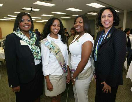 Jackie Gorman-Johnson (Board Chair Elect), Selena Mitchell (Girl Board Member), Arleya Horne (Gold Award Recipient) and Anna Maria Chávez (CEO Girl Scouts of Southwest Texas) were at the African American Women's Leadership Summit on Nov. 7, 2009, at the Sally Cheever Girl Scout Leadership Center. Photo: LELAND A. OUTZ, Express-News File Photo / SAN ANTONIO EXPRESS-NEWS