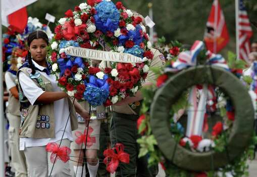 Julia Bussey, a Girl Scout Juliet, carries a wreath with other scouts from San Antonio, during the Veterans Day Ceremony at Fort Sam Houston National Cemetery, Thursday, Nov. 11, 2010. Photo: Bob Owen, Express-News File Photo / rowen@express-news.net