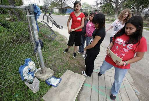 Girls working on a Girl Scout project stop to observe a shrine set up for someone who died in the Edgewood area. Girls Scouts take photos on the West Side to document what makes it easy or hard to be physically active in their community, Monday, March 15, 2010. Photo: BOB OWEN, Express-News File Photo / rowen@express-news.net
