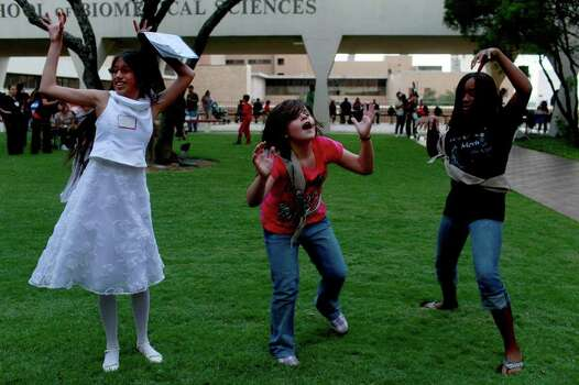 "Jocelyn Balderas (from left), 12, dances to the Michael Jackson song, ""Thriller,"" with members of Girl Scout Troop 1915 including Emily Lewis, 11, and Suncerie Daye, 11, who led a dance station during the PREMIEre Reunion at the UT Health Science Center in San Antonio on Thursday, Oct. 21, 2010. Photo: LISA KRANTZ, Express-News File Photo / SAN ANTONIO EXPRESS-NEWS"