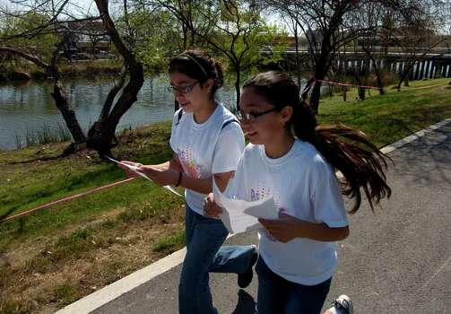 "Krystal Lemus (left) and Maria Sierra hustle along a path in the Apache Park Greenway on March 12, 2011, during a scavenger hunt as part of the Girl Scout's ""Be Fit With Friends"" program. Ther event was sponsored by the Girl Scouts of Southwest Texas and UT Health Science Center. Photo: Express-News File Photo"