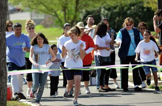 "Participants leave the starting line of the Girl Scouts ""Be Fit With Friends"" scavenger hunt on March 12, 2011, at Apache Park Greenway. The event was co-sponsored by UT Health Science Center. Photo: Express-News File Photo"