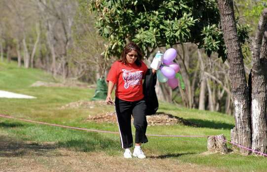 "Mary Lemus looks for items in Apache Park Greenway on March 12, 2011, while participating in the Girl Scouts ""Be Fit With Friends"" scavenger hunt. The event was co-sponsored by the UT Health Science Center. Photo: Express-News File Photo / Robert Jerstad"