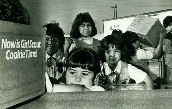 Girl Scouts Vanessa Rodriguez (front), Terri Alardon (left), Audrey Esquivel and Valerie Valliez sell cookies in the San Antonio area in February 1987. Photo: Express-News File Photo