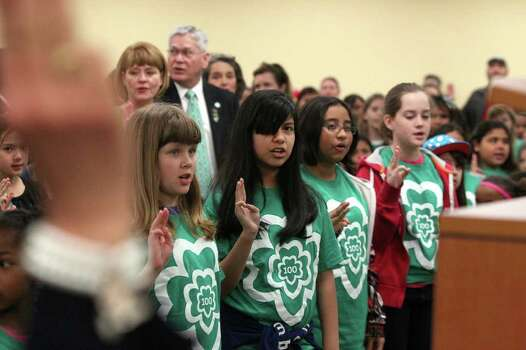 "Girls make their pledge at the Sally Cheever Girl Scout Leadership Center during a celebration of their 100th anniversary. The Girl Scouts of Southwest Texas also announced the ""ToGetHer- There"" initiative. Photo: JOHN DAVENPORT, San Antonio Express-News / SAN ANTONIO EXPRESS-NEWS (Photo can be sold to the public)"