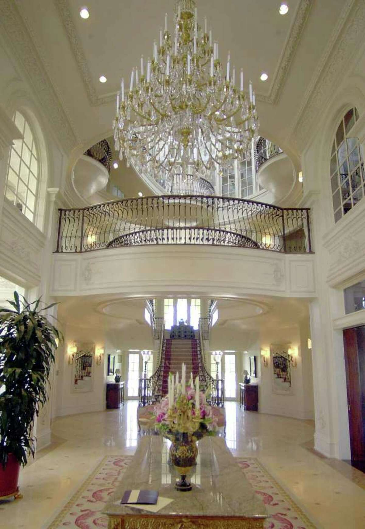 In this April 30, 2003 file photo, the main entry of the Champ d'Or home is shown in Hickory Creek, Texas. The 48,000-square foot mansion that cost $46 million to build and was modeled after a French landmark is going on the auction block later this month, where it could be sold for around $10 million. (AP Photo/LM Otero, File)