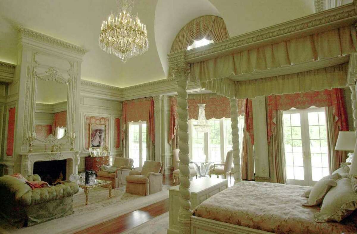 This April 30, 2003 file photo shows the master bedroom of the Champ d'Or home located in Hickory Creek, Texas. The 48,000-square foot mansion that cost $46 million to build and was modeled after a French landmark is going on the auction block later this month, where it could be sold for around $10 million. (AP Photo/L.M. Otero, File)