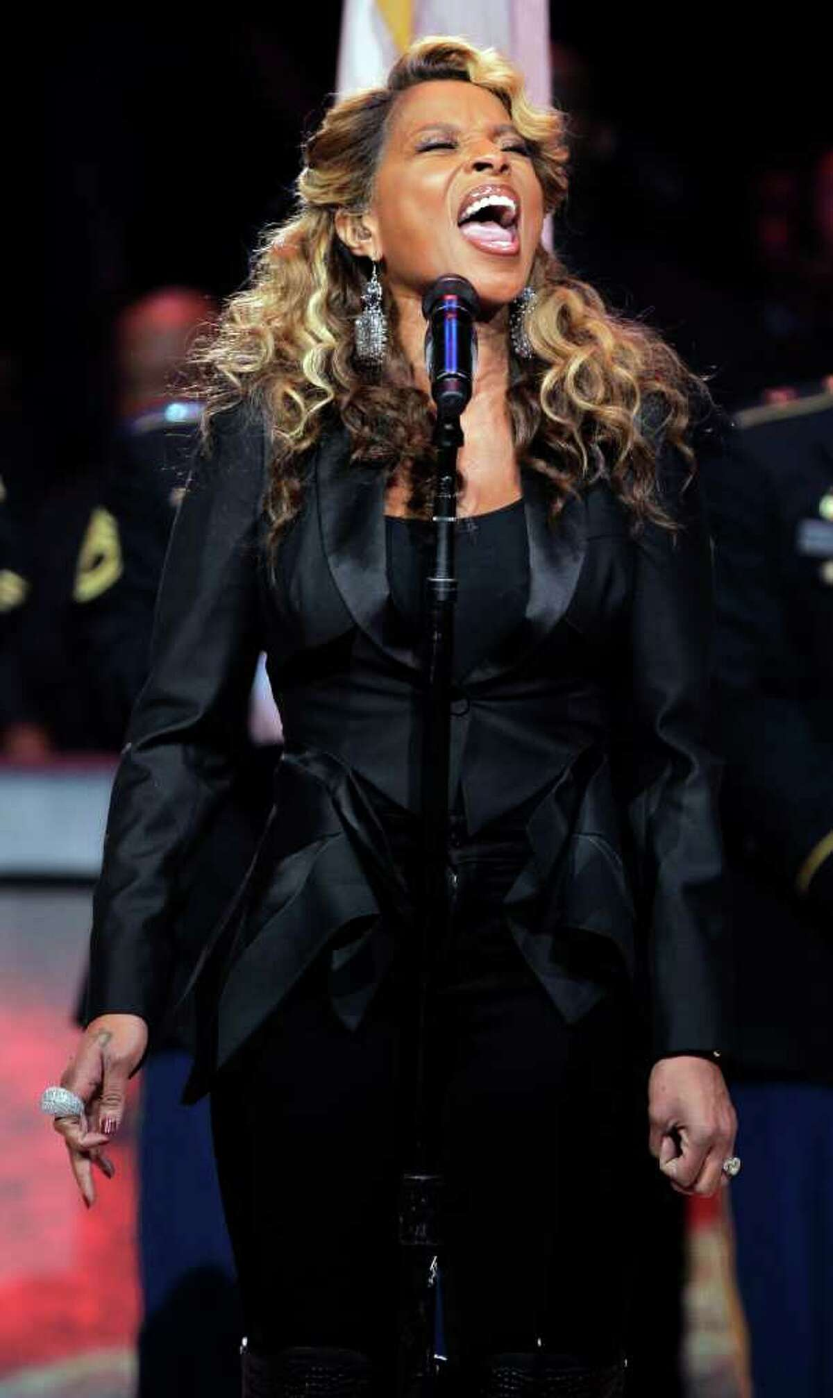 Singer Mary J. Blige performs the national anthem before the NBA All-Star basketball game, Sunday, Feb. 26, 2012, in Orlando, Fla.