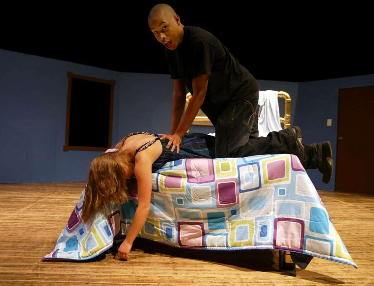 Stratford High School students, (L-R) Isaiah Scales and Alex Arendt rehearse a scene from the school production of Cactus Flower, which opens Nov. 13, 2009 in Stratford, Wednesday, Nov. 11, 2009.