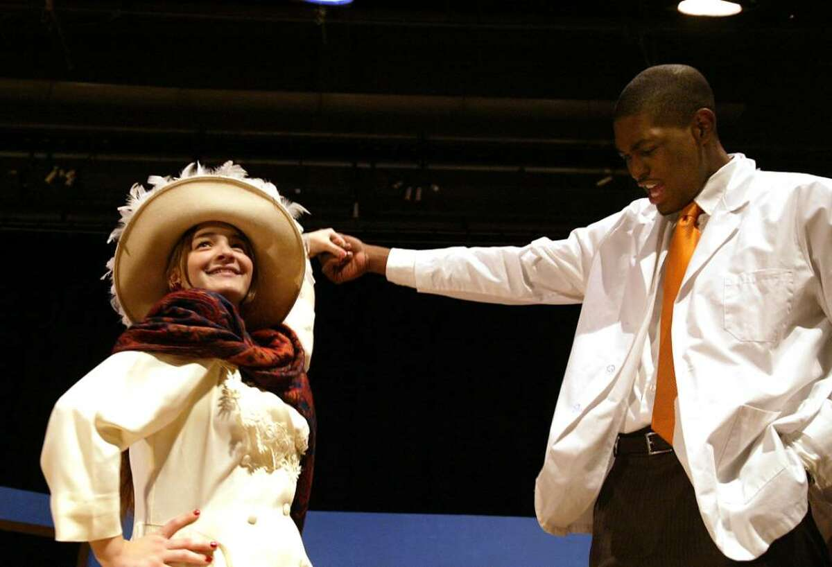 Stratford High School students (L-R) Jillian Valle and Brandon Sherrod rehearse a scene from the school production of Cactus Flower, which opens Friday, Nov. 13, 2009 at the school.Wednesday, Nov. 11, 2009.