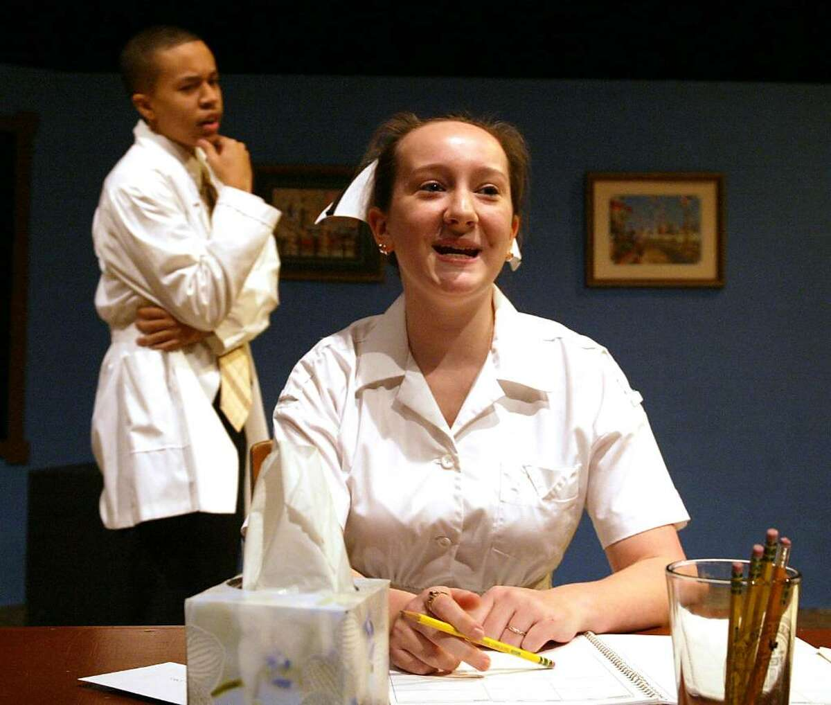 Stratford High School seniors, (L-R) Joshua Anderade and Torry Tallberg rehearse a scene from the school production of Cactus Flower, which opens Nov. 13, 2009 in Stratford, Wednesday, Nov. 11, 2009.