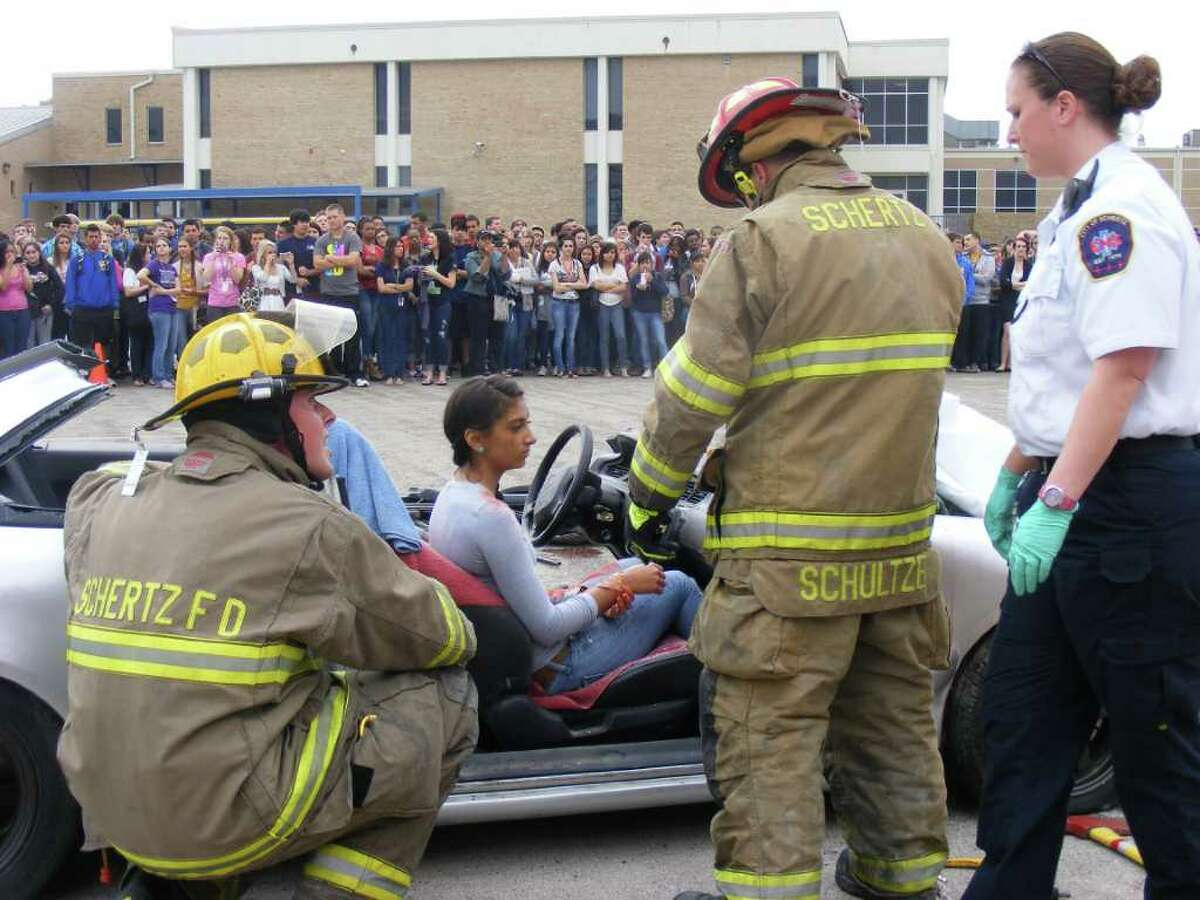 Clemens student Farrah Wilson is a passenger in one of two wrecked cars used to simulate a